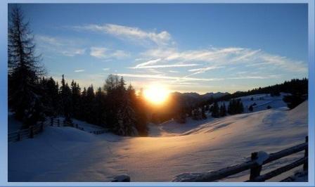 alba sulla neve