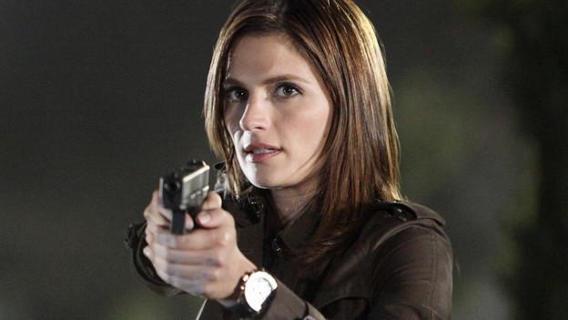p 19 ragazza con pistola